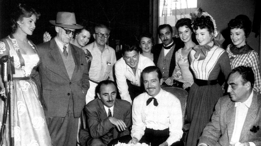 With director Allan Dwan, Angie Dickinson, John Alton, Ronald Reagan, John Payne, Coleen Gray and producer Benedict Bogeaus